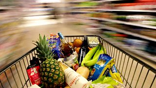 Shopping trolley filled with food