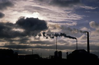 Factory chimneys producing smoke