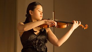 Solo performer practicing violin