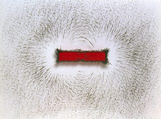 Iron filings in the magnetic field around a bar magnet.