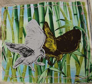 Cut-out printed bird images on bamboo print textile background