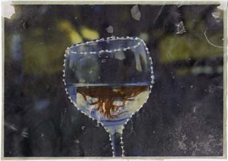 Hand-coloured photograph of a wine glass with stitched contour lines