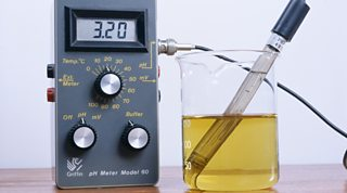 A pH meter with its pH probe in an acidic solution