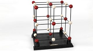 3D construction model showing the arrangement of ions in a lattice structure.