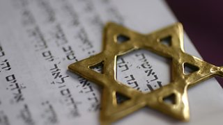 A Golden Star of David over the first word of the book of Genesis