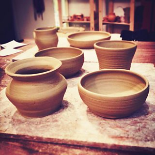 Greenware pots ready to be fired