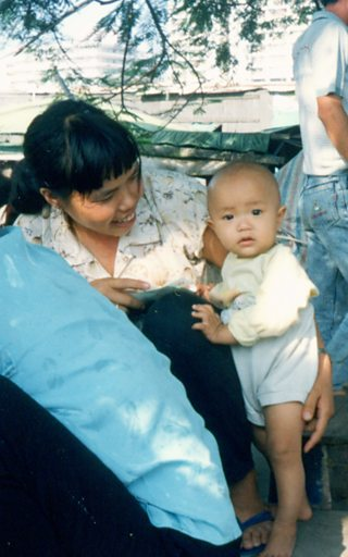 A Chinese woman with a young child. Image by morguefile.com user npclark2k