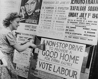 A woman plasters a poster onto a well. Text: A non-stop drive to provide a good home for every family. Vote Labour.