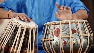 This is a picture of a person playing the tabla
