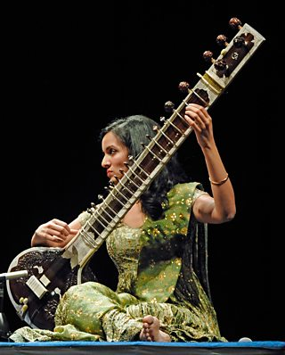 Woman playing the sitar