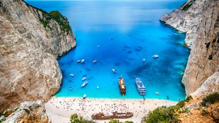 Photograph of Limestone cliffs surrounding Navagio Bay, Greece