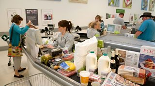 A supermarket checkout.Supermarkets operate in the private sector