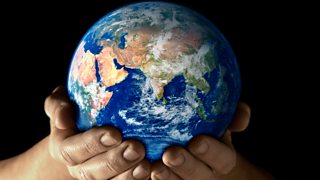 Photograph of world in hands