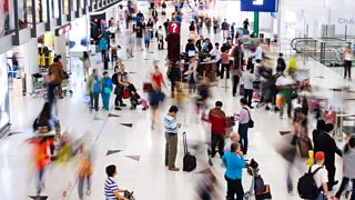 Photograph of people at an airport
