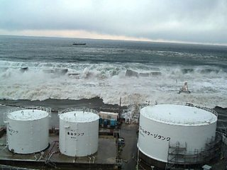 An image of the 2011 tsunami taken from the Fukushima No 1 nuclear power plant. Giant waves are advancing towards the power plant.