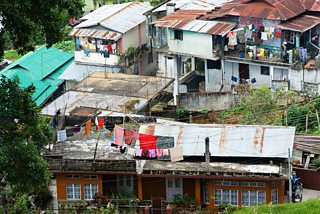 Rows of houses with tin roofs in Meghalaya, India.