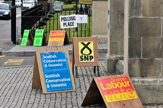 Campaign posters at a polling station in Stirling