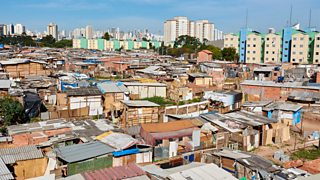 Photograph of High rise buildings in central São Paulo and a favela in São Paulo