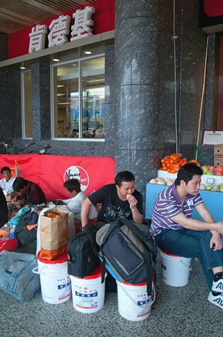 Migrant workers from the countryside at Guangzhou train station, Guangdong province