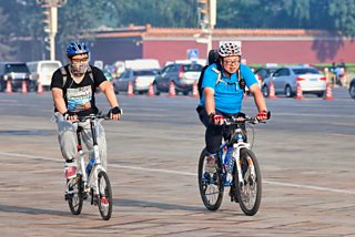 Two overweight cyclists commuting in Beijing