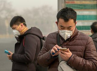 People wearing masks to protect against air pollution in Beijing