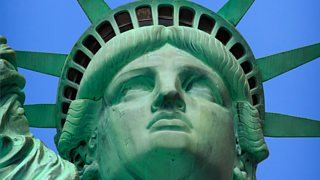 Close up of the Statue of Liberty's head and shoulders with green discolouration visible on its copper surface