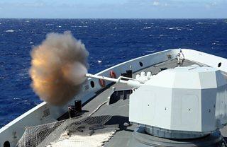 Chinese Navy multi-role frigate Hengshui fires its main gun