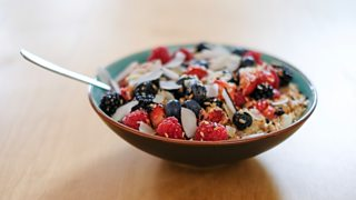 Bowl of porridge with strawberries and blueberries