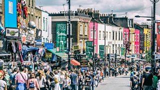 Shoppers walking in busy street in London