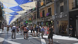A high street with shoppers in Madrid