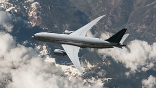 Birds' eye view of aeroplane flying over mountains