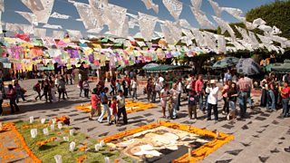 Flags and marigolds laid out for Day of the Dead festival
