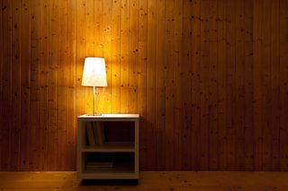 A lamp lighting a dark room