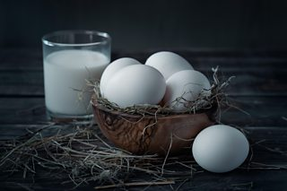 A photo of eggs and milk