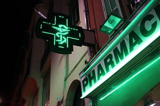 A photo of neon lights outside a pharmacy/drugstore