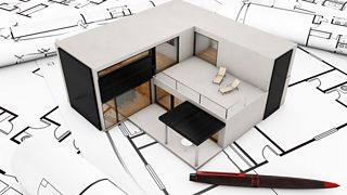 A model building plan design of a stylish home placed on top of drawings of floor plans.