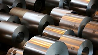 A collection of galvanised steel rolls standing before the polymer coating process.