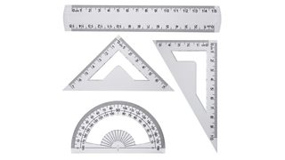 A geometry set including a plastic ruler, a 180 degree protractor and two set squares.