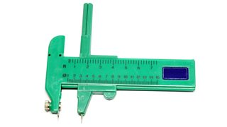 A green compass cutter on a white background.