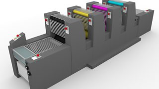 A grey printing press with four modules for each colour of CMYK (magenta, cyan, yellow and black).