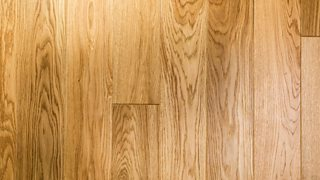 A close-up of the grain texture of waxed oak wooden flooring.