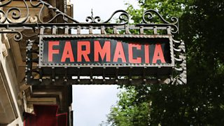 Spanish pharmacy sign on side of building