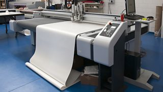 A vinyl cutting machine in the process of cutting.