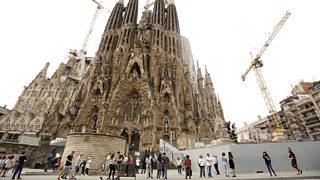 People standing outside the Sagrada Familia.