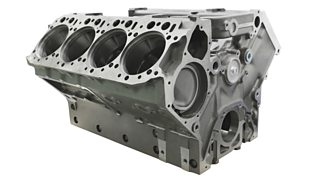 An isolated cylinder block of a truck engine on a white background.
