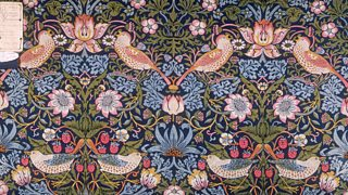 A pink and blue floral wallpaper design with birds.