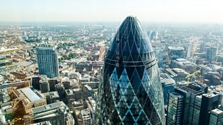 A landscape skyline photo of London featuring The Gherkin.