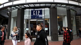 A GAP shopfront with people walking past.