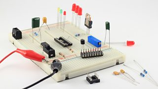 A side view of a prototype of a solderless breadboard with components placed on top.