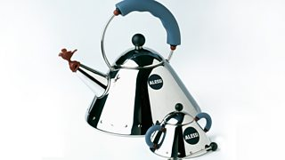 A large and small kettle made with a reflective material placed side by side.